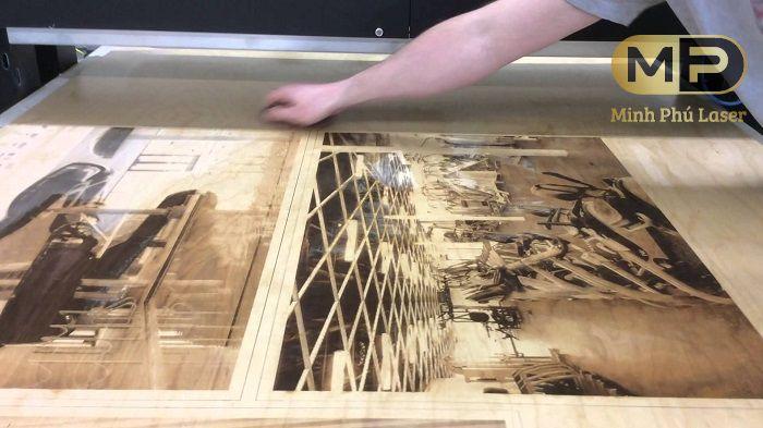Hoạt động khắc laser lên tranh gỗ tại Xưởng khắc laser Minh Phú